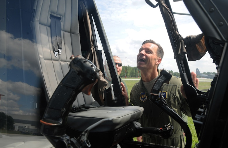 """Brig. Gen. Mark Dillon, 86th Airlift Wing commander, admires the inside of a Polish air force Mi-series helicopter during a visit to Powidz Air Base, Poland, July 26, 2011. Dillon made his annual visit to Powidz after signing a letter of intention last year in June. By singing the letter of intention, the 86th AW and the 3rd AW became """"sister wings"""" in an effort to improve operational capabilities. (U.S.  Air Force photo by Staff Sgt. Tyrona Lawson)."""