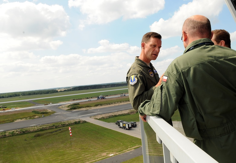 """Brig. Gen. Mark Dillon, 86th Airlift Wing commander, and Polish air force Col. pil. Slawomir Zakowski, 3rd Airlift Wing commander, tour the control tower and view the airfield during a visit to Powidz Air Base, Poland, July 26, 2011. Dillon made his annual visit to Powidz after signing a letter of intention last year in June. By singing the letter of intention, the 86th AW and the 3rd AW became """"sister wings"""" in an effort to improve operational capabilities. (U.S.  Air Force photo by Staff Sgt. Tyrona Lawson)."""