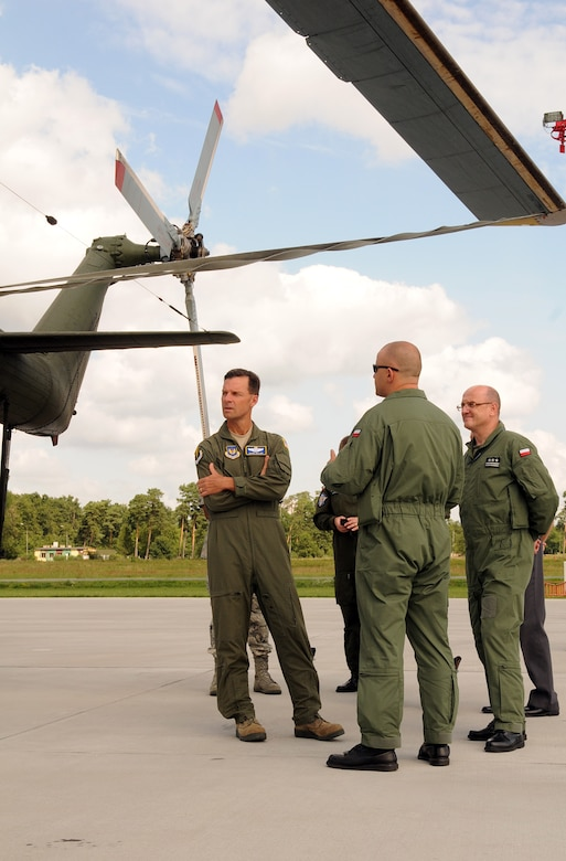 """Brig. Gen. Mark Dillon, 86th Airlift Wing commander, along with Polish air force Col. pil. Slawomir Zakowski, 3rd Airlift Wing commander, receives a tour of one of the many aircraft utilized by the 3rd Airlift, July 26, 2011, Powidz Air Base, Poland. During his visit to the """"sister wing"""", Gen. Dillon also toured the new control tower and a new hanger built for C-130 aircraft maintenance. (U.S.  Air Force photo by Staff Sgt. Tyrona Lawson)."""