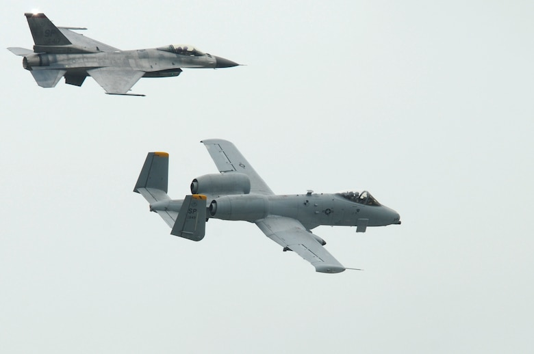 SPANGDAHLEM AIR BASE, Germany – An A-10 Thunderbolt II, bottom, flies alongside an F-16 Fighting Falcon during a demonstration at the Spangdahlem Air Base Open House here July 31. The 52nd Fighter Wing welcomed about 40,000 visitors from across Europe who visited the base and learned about daily operations. (U.S Air Force photo/Tech. Sgt. Jonathan Pomeroy)