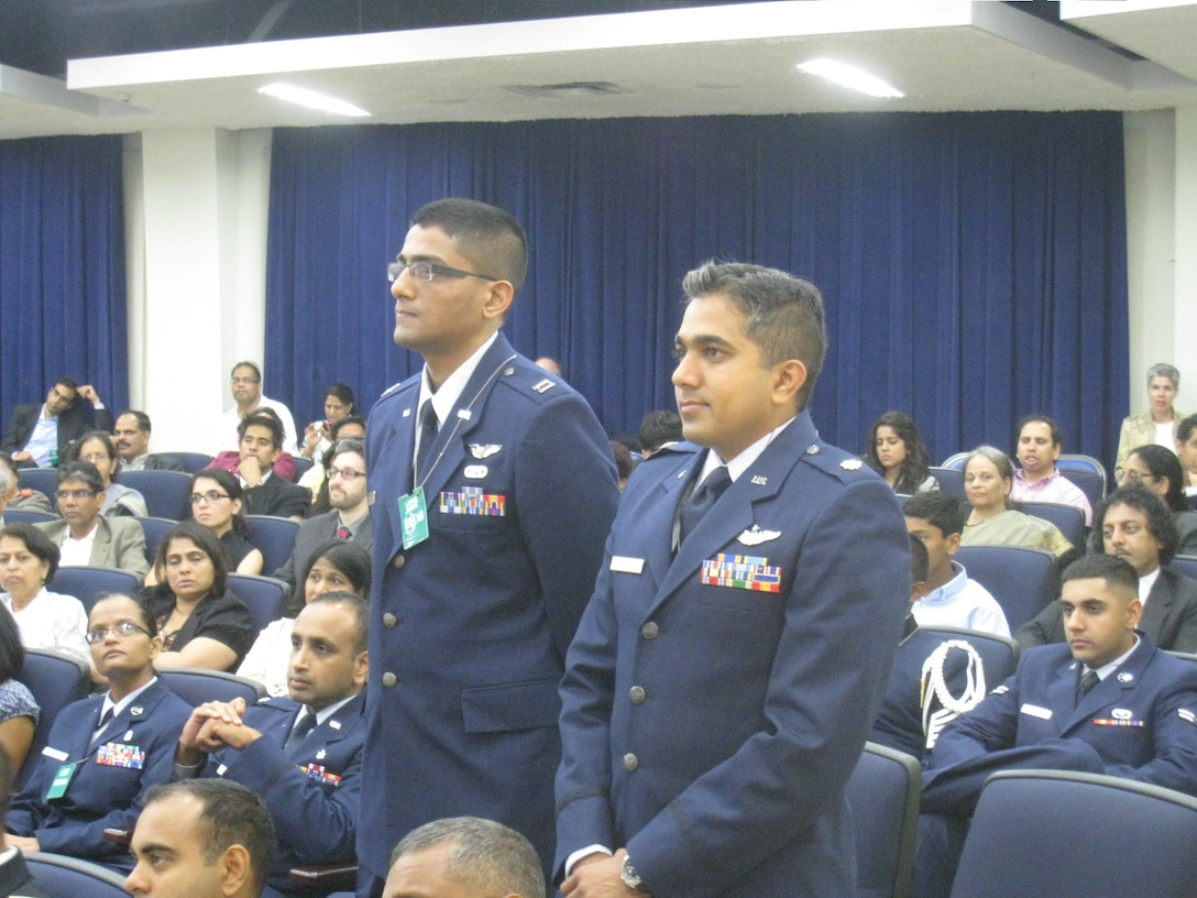 """Capt. Iyer Srivats, 349th Air Mobility Wing C-5 pilot, and Maj. Raj Shah, 177th Fighter Wing F-16 pilot are recognized at a White House summit July 29, for executing numerous combat missions in Southwest Asia since Sept. 11, 2001. The summit, """"Impacting change in America and abroad,"""" recognized the contributions of South Asian Americans. The event marked the first time South Asian American military heritage was honored at the White House. (U.S. Air Force photo/courtesy photo)"""