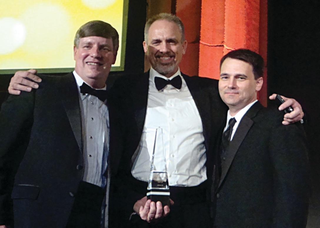 X-51A Team members Charles Brink, George Thum and Joseph Vogel accept the Aviation Week award at a black-tie dinner in March 2011 in Washington, D.C.  Awards are given based on work done the previous calendar year.   (Air Force Image)