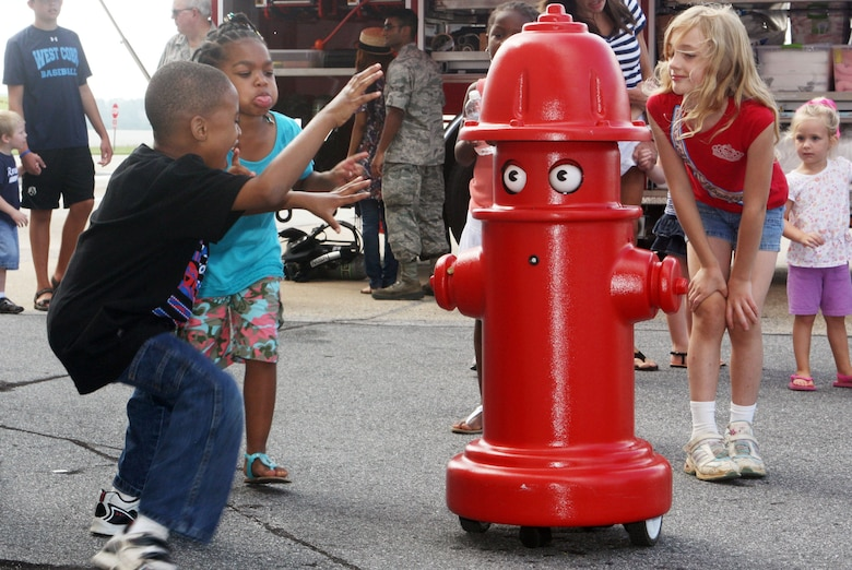 """Pluggie"" the robotic spokesman from the 94th Civil Engineer Squadron, Fire Department, was a huge hit with the kids. (U.S. Air Force Photo/Don Peek)"