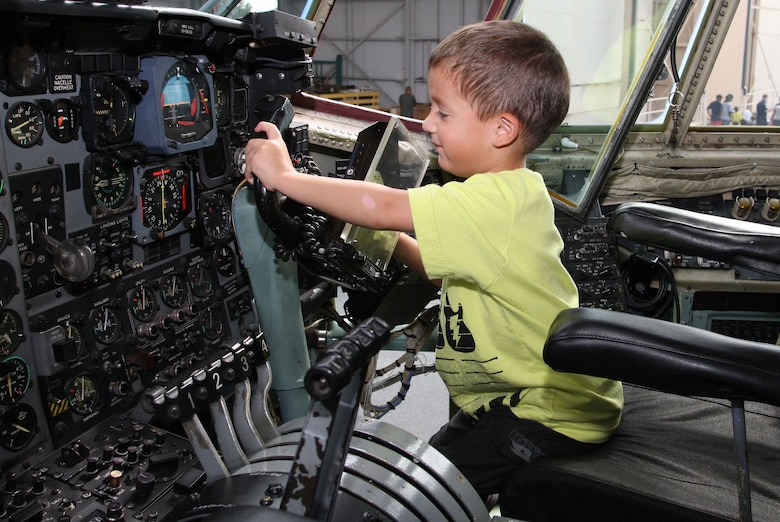 The C-130 static offered the opportunity for kids to try out the pilot and co-pilot seats. (U.S. Air Force Photo/Don Peek)