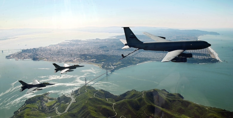 Flying over the San Francisco Bay, two F–16 Fighting Falcons move into a precontact position with a KC–135E Stratotanker before refueling during an Operation Noble Eagle training patrol.