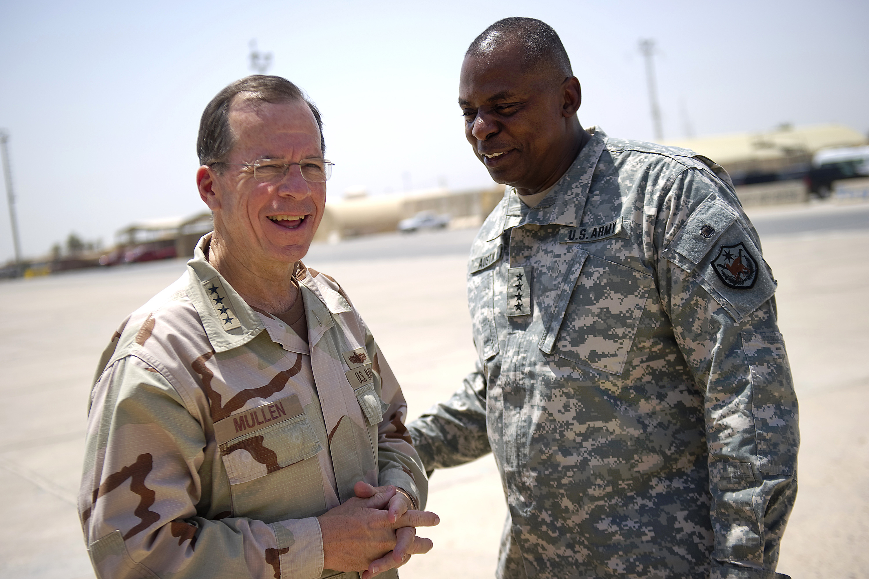 U.S. Army Gen. Lloyd Austin, commander of U.S. Forces-Iraq, bids farewell to U.S. Navy Adm.