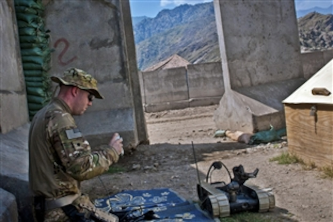 U.S. Army Spc. Andrew B. Clemen gets a refresher course on a Pacbot 310 EOD robot at Combat Outpost Honaker-Miracle in eastern Afghanistan's Kunar province, Aug. 1, 2011. Clement is an explosive ordnance disposal technician assigned to the 25th Infantry Division's 129th Ordnance Company, 3rd Brigade Combat Team.
