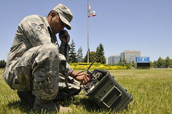 Senior Airman Deepak Prasad, a ground radio technician assigned to the 129th Communications Flight, conducts operational check on a ground radio TRC-176 communication system via satelite channel at Moffett Federal Airfield, Calif., July 10, 2011.  Prasad is featured in this month's Portrait of a Professional. (California Air National Guard photo by Airman 1st Class John Pharr)
