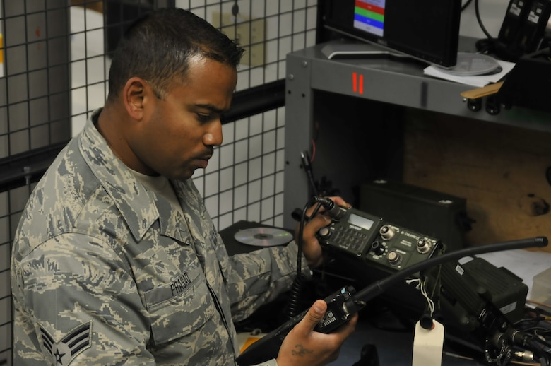 Senior Airman Deepak Prasad, a ground radio technician assigned to the 129th Communications Flight, conducts operational check on a ground radio TRC-176 communication system at Moffett Federal Airfield, Calif., July 10, 2011. Prasad is featured in this month's Portrait of a Professional. (California Air National Guard photo by Airman 1st Class John Pharr)