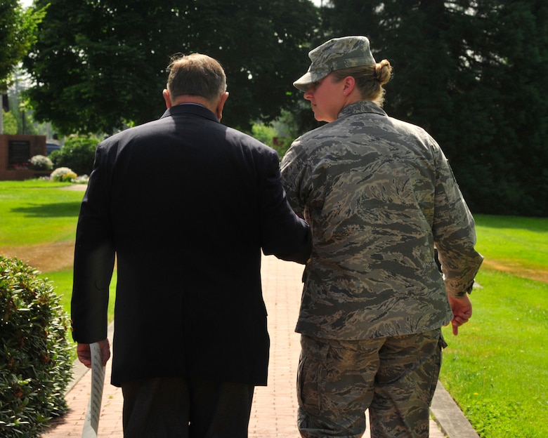 Master Sgt. Brenda Degnan (right), 62nd Maintenance Squadron, walks with retired Col. Joe Jackson, Medal of Honor recipient, toward the Prisoner of War/Missing In Action Memorial for her re-enlistment July 29, 2011, at Joint Base-Lewis McChord, Wash. Jackson administered the Oath of Enlistment to Degnan. (U.S. Air Force Photo/Staff Sgt. Frances Kriss)
