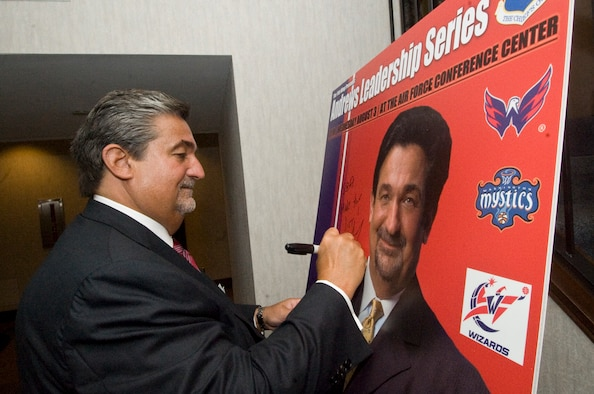 Mr. Ted Leonsis, founder and chairman of Monumental Sports and Entertainment signs his Andrews Leadership Poster after the seventh installment of the Andrews Leaders Series in the Air Force Conference Center here Aug. 3. The monthly guest speaker forum provides a unique venue for nationally recognized leaders to motivate and inspire Joint Base Andrews military and civilian personnel. (Photo by Bobby Jones)