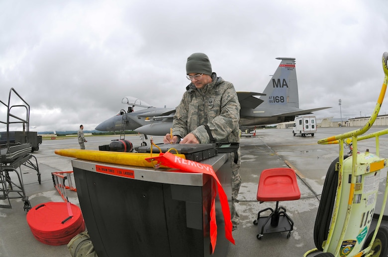 Master Sergeant Turner Fowks, 104th Fighter Wing crew chief, completing necessary maintenance forms after the Mass. Air National Guard F-15 completed a training flight while deployed to Joint Base Elmendorf-Richardson, Alaska. (U.S. Air Force Photo by: Technical Sergeant, Anthony M. Mutti)