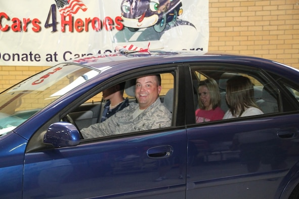 Master Sgt. Jeff Norling along with his family prepare to take their new car for a spin following the ceremony. (Photo by: Capt Joe Blubaugh)