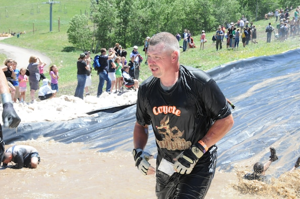 Senior Master Sgt. Brian Willard catches his breath after completing the final obstacle. (photos by Master Sgt. Allen Pickert)