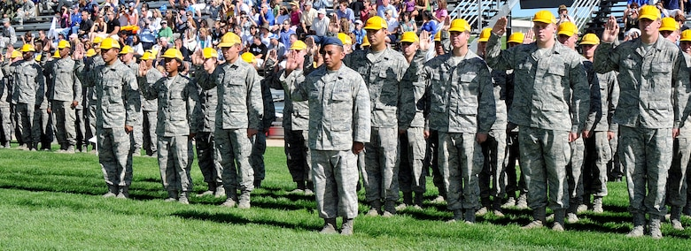 Members of the Air Force Academy's Class of 2015 take the Honor Oath during the Academy's Acceptance Day Parade Aug. 3, 2011. Cadets may not lie, steal or cheat, nor tolerate among their ranks anyone who does. In addition, they swear to do their duty and to live honorably. (U.S. Air Force photo/Megan Davis)