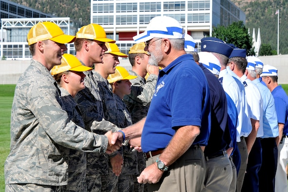Members of the Air Force Academy's Class of 1975 congratulate cadets in the Class of 2015 on their formal acceptance into the Cadet Wing during the Acceptance Day Parade Aug. 3, 2011. The Class of 1975 is the legacy class for the new freshmen. (U.S. Air Force photo/Megan Davis)