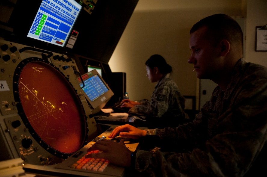 Senior Airman Jeffrey Giles, 39th Operations Squadron air traffic control journeyman, and Tech. Sgt. Rosalyn Reola, 39th OS radar approach control watch supervisor, monitor RAPCON screens Aug. 3, 2011, at Incirlik Air Base, Turkey. RAPCON airmen work with the Turkish air force to ensure the safe and smooth operation of all air traffic operations within 50 nautical miles of Incirlik. (U.S. Air Force photo by Airman 1st Class Clayton Lenhardt/Released)
