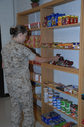 1st Lt. Sarah Ray, adjutant, Marine Corps Logistics Base Albany, looks at the variety of snack items available in the Building 3500 snack bar, Aug. 5.