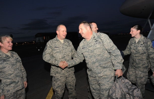 Oregon Air National Guard Command Chief Master Sgt. James Hotaling welcomes back Lt. Col. Ted Lawson and other members of the 116th Air Control Squadron as they arrive at the Portland Air National Guard Base, Portland, Ore. on July 20, 2011.  Members of the 116th ACS, based out of Camp Rilea, Ore. have just returned from a four-mouth deployment to the Middle East. (U.S. Air Force photo by Tech. Sgt. John Hughel, 142 Fighter Wing public affairs)
