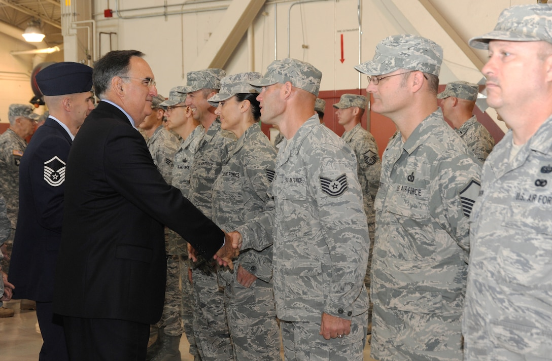 Oregon Chief Justice Paul De Muniz greets the Airmen of the 116 Air Control Squadron, on behalf of the Governor of Oregon, at a demobilization ceremony, July 24 at the Portland Air National Guard Base in Portland, Ore. Each of the Airmen recieved a Governors Coin in recognition of their accomplishments during the deployment. The Airmen recently returned from a four month deployment to the Middle East where they supported area operations in air control missions. (U.S. Air Force photo by Tech. Sgt. John Hughel, 142 Fighter Wing public affairs)