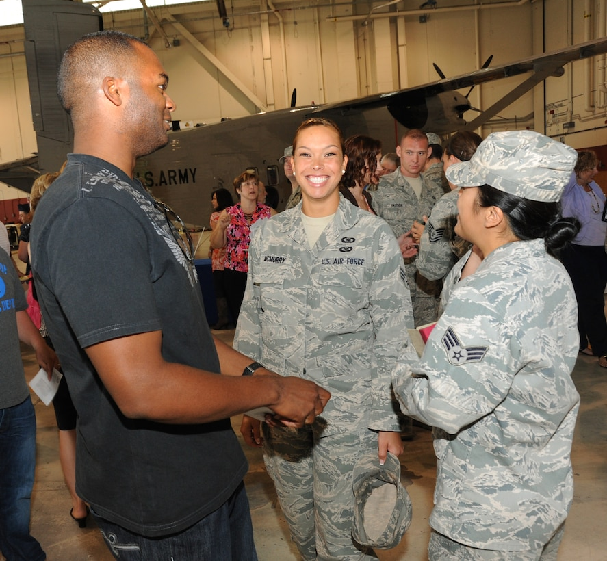 Senior Airman Miyoshi McMurry (center) and other Airmen of the 116 Air Control Squadron, Oregon Air National Guard, are happy to be home and take part in theirdemobilization ceremony, July 24 at the Portland Air National Guard Base in Portland, Ore. The Airmen of the 116th ACS recently returned from a four month deployment to the Middle East where they supported area operations in air control missions. (U.S. Air Force photo by Tech. Sgt. John Hughel, 142 Fighter Wing public affairs)