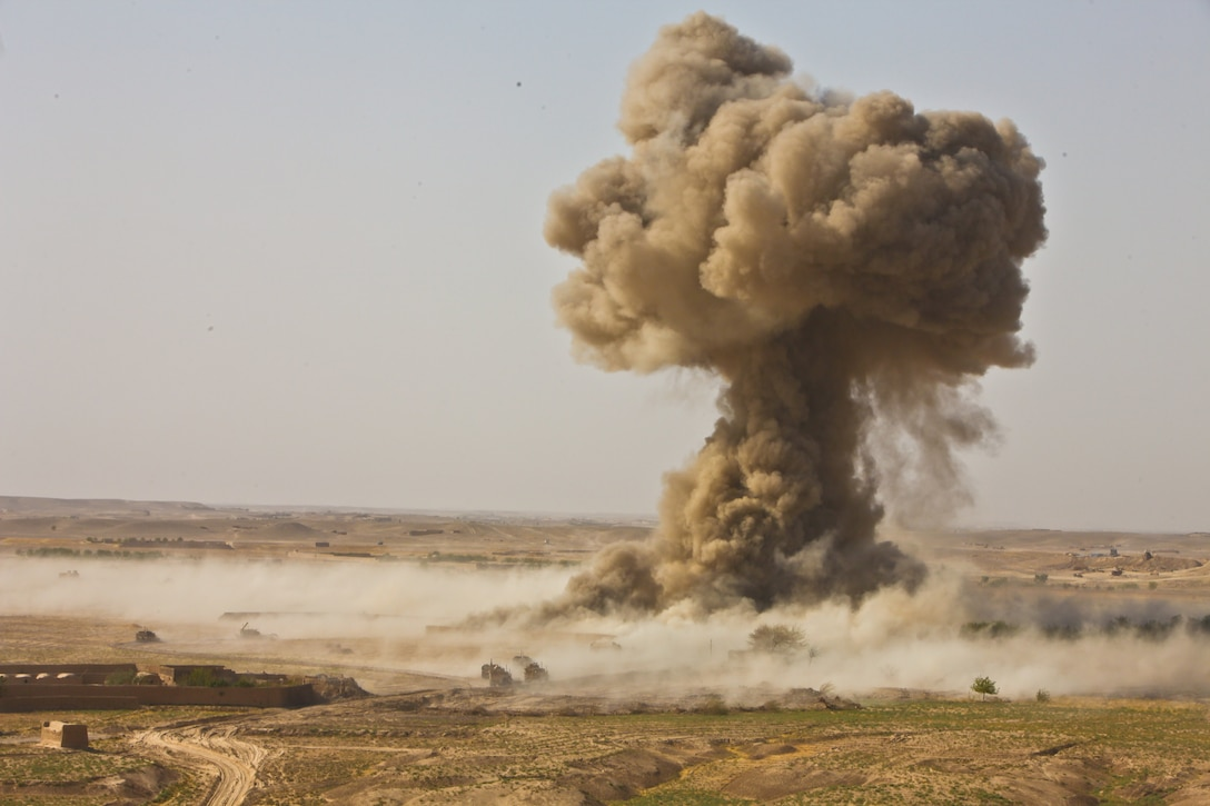 A mushroom cloud rises into the air above the Ladar Bazaar after Marines with 2nd Combat Engineer Battalion detonate a line charge.  Second CEB leveled the marketplace to eliminate the threat of Improvised Explosive Devices.  Local residents expressed a concern for their safety due to insurgent activity in the area and have been unable to use the bazaar for some time.
