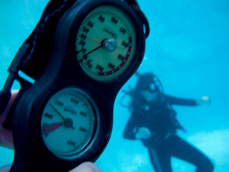 WAITING TO INHALE - Using their depth gauge, the diving duo realized they had gone 65 feet in the wrong direction to a depth of 80 feet in the murky waters of St. Andrew's Bay, Fla. (Photo by TSgt Samuel Bendet)