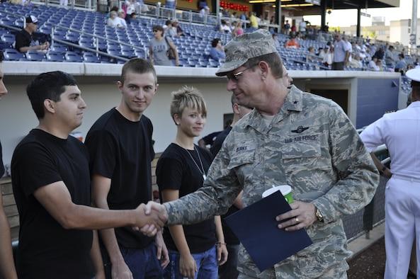 Brig. Gen. Burks congratulating new NV ANG enlistees at the Reno Aces Military Appreciation Night