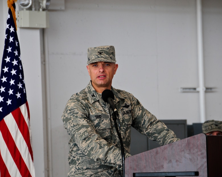 Col. Sami Said, 144th Fighter Wing Commander, adresses the Airmen of the 144th Maintenance Group during a change of command ceremony August 7, 2011. Col. Mark Favetti assumed command of the 144th Maintenance group during the ceremony.