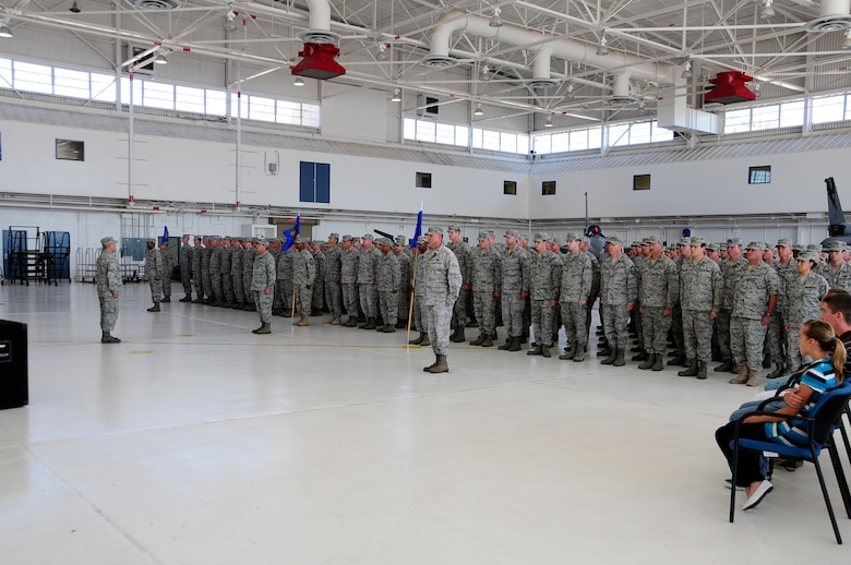 Members of the 144th Maintenance Group stand in formation during a change of command ceremony. Col. Mark Favetti assumed command of the 144th Maintenace group in a change of command ceremony August 7 2011.