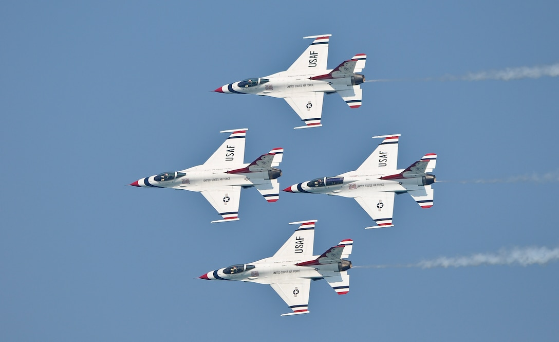 The Thunderbirds fly in a diamond formation over Bradford Beach during the 2011 Milwaukee Air and Water Show on Saturday, August 6.  The air show took place Saturday and Sunday, and the Thunderbirds flew both days.  (U.S. Air Force photo by Staff Sgt. Jeremy Wilson / Released)