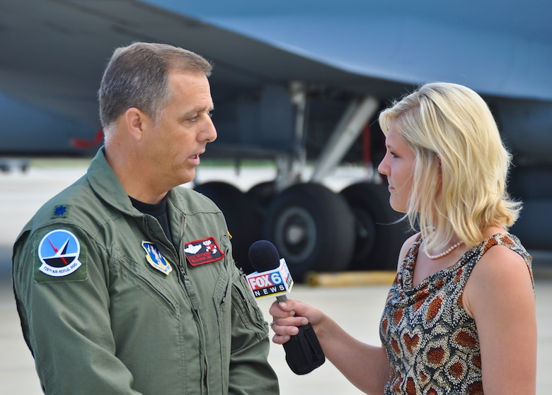 Lt. Col. Pete Hoffman, the 126th Air Refueling Squadron commander, discusses the 128th Air Refueling Wing's role in the Milwaukee Air and Water Show with Laura Langemo, an assignment reporter for Milawukee's Fox 6 News, on Saturday, August 6.  The 128th Air Refueling Wing hosted the Air Force Thunderbirds air demonstration team throughout the air show and provided support for the Las Vegas-based team.  The Thunderbirds' F-16C Falcons are home stationed at Nellis Air Force Base, Nevada, and they perform 70 shows per year with venues overseas and in the United States.  (U.S. Air Force photo by Staff Sgt. Jeremy Wilson / Released)