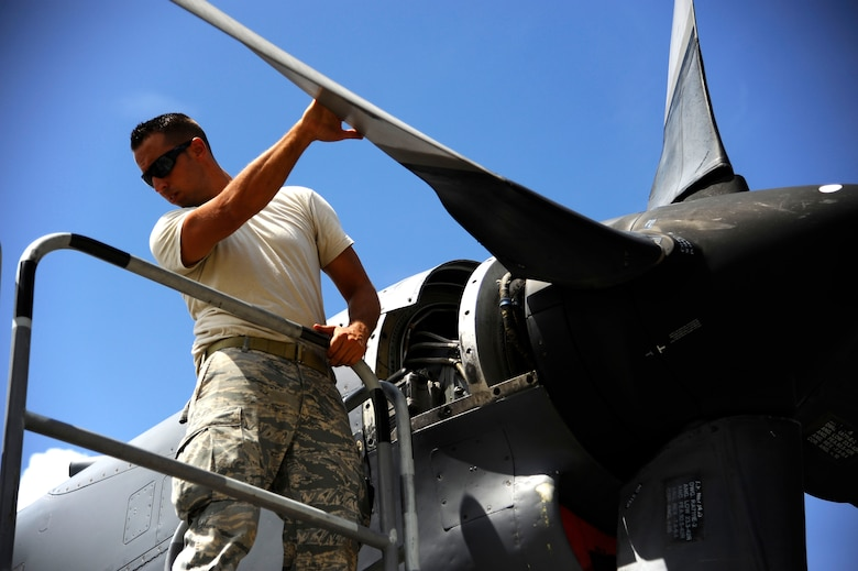 U.S. Air Force Staff Sgt. Todd Bishop, 1st Special Operations Maintenance Squadron aerospace propulsion journeyman, troubleshoots an MC-130H Combat Talon II engine on the flightline at Eglin Air Force Base, Fla., July 25, 2011.  The 1st SOMXS's mission is to organize, train and equip Airmen to perform aircraft maintenance and back shop support for the MC-130P Combat Shadow flown by the 9th Special Operations Squadron as well as other special operation aircraft. (U.S. Air Force photo by Airman Gustavo Castillo)