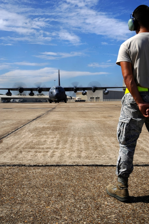 U.S. Air Force Senior Airman Jarred Shockey, 1st Special Operations Maintenance Squadron crew chief, observes an MC-130P Combat Shadow running pre-flight checks on the flightline at Eglin Air Force Base, Fla., July 25, 2011.  Part of a crew chief's job is using technical data to diagnose maintenance problems on aircraft systems and interpreting and advising on maintenance procedures and policies to repair aircraft and related equipment. (U.S. Air Force photo by Airman Gustavo Castillo)
