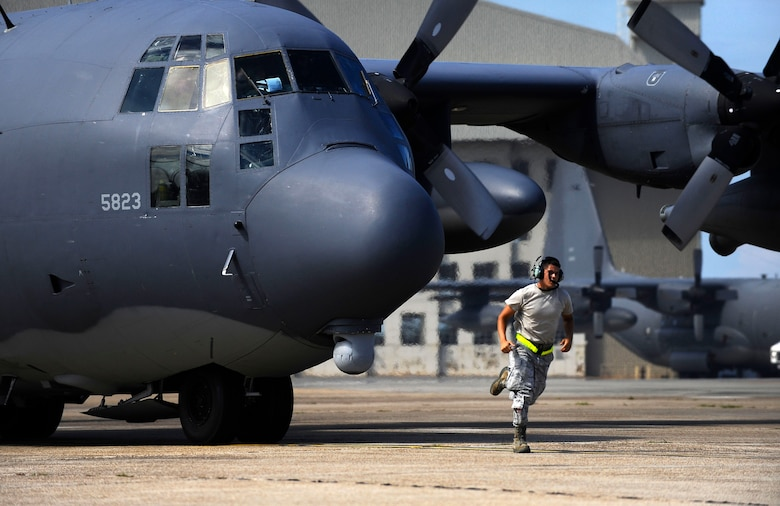 U.S. Air Force Senior Airman Jarred Shockey, 1st Special Operations Maintenance Squadron crew chief, runs to get in place as an MC-130P Combat Shadow finishes preflight checks during an exercise on the flightline at Eglin Air Force Base, Fla., July 25, 2011.  As a crew chief, Shockey has the responsibility to service the aircraft, perform inspections and advise on any problems with maintaining, servicing and inspecting aircraft. (U.S. Air Force photo by Airman Gustavo Castillo)