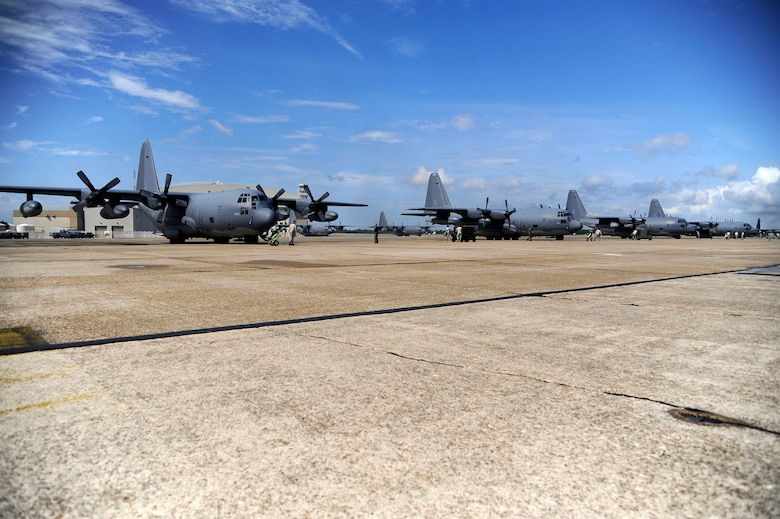 Airmen from the 1st Special Operations Maintenance Squadron conduct preflight checks on four MC-130P Combat Shadows and two MC-130H Combat Talon IIs during a training exercise on the flightline at Eglin Air Force Base, Fla., July 25, 2011.  Five of these aircraft departed simultaneously creating a rare dissimilar formation normally reserved for combat in deployed environments. (U.S. Air Force photo by Airman Gustavo Castillo)