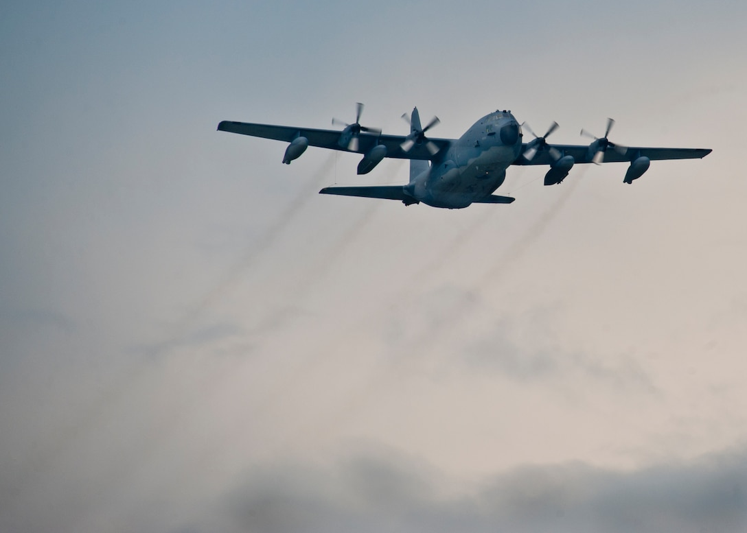 A MC-130E Combat Talon I passes over the Duke Field runway before bringing home more than 25 Airmen back to their families after a deployment to Southwest Asia, Aug. 7.  (U.S. Air Force photo/Tech. Sgt. Samuel King Jr.)