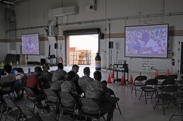 """Airmen of the 148th Fighter Wing, Duluth, Minn, watch the Minnesota Twins play from the fuel cell while in Duluth, Minn. On August 7, 2011. Fox Sports North (FSN) and the Minnesota Twins supported the First Lady's """"Joining Forces"""" campaign by celebrating military members and their families during a series of Sunday Twins Games where they will be airing their pre and post game shows from various military installations. (U.S. Air Force photo by Staff Sgt. Donald L. Acton)"""