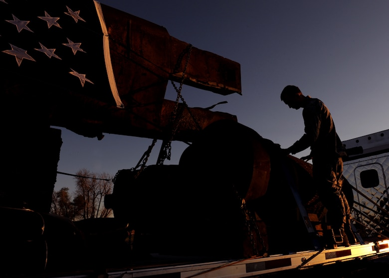 BUCKLEY AIR FORCE BASE, Colo. -- An airman touches the World Trade Center pieces in remembrance Aug. 7, 2011. Having traveled from the Port Authority of New York and New Jersey, the WTC pieces rest at Buckley Air Force Base before being moved to Denver for the 10th anniversary of 9/11. (U.S. Air Force photo by Senior Airman Marcy Glass)