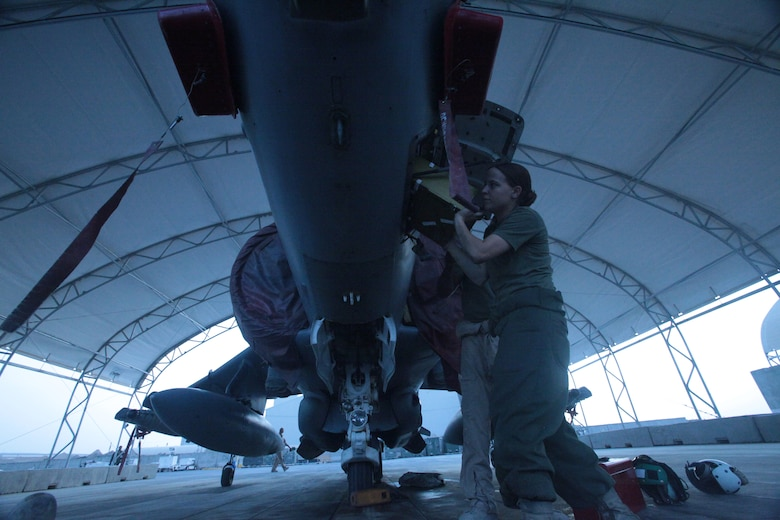 Cpl. Ashley Zifko, a Marine Attack Squadron 513 avionics technician and Two Rivers, Wis., native, installs an inertial navigation unit on one of the AV-8B Harriers on the flightline of Kandahar Airfield, Afghanistan, Aug. 9.