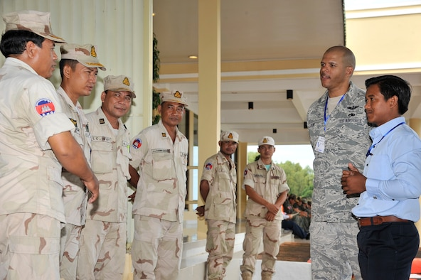 SIHANOUKVILLE, Cambodia – Master Sgt. James Bonk meets with Royal Cambodian Armed Forces during a subject-matter expert exchange here Aug. 8, 2011. The exchange was part of PACIFIC ANGEL 11-1, which partners U.S. and Cambodian military and civilian personnel to provide medical, dental, optometry and engineer programs to local Cambodians as well as airfield operations subject-matter expert exchanges. Sergeant Bonk is a contingency response team lead assigned to the 36th Mobility Response Squadron, Andersen Air Force Base, Guam. (U.S. Air Force photo/Staff Sgt. Christopher Boitz)