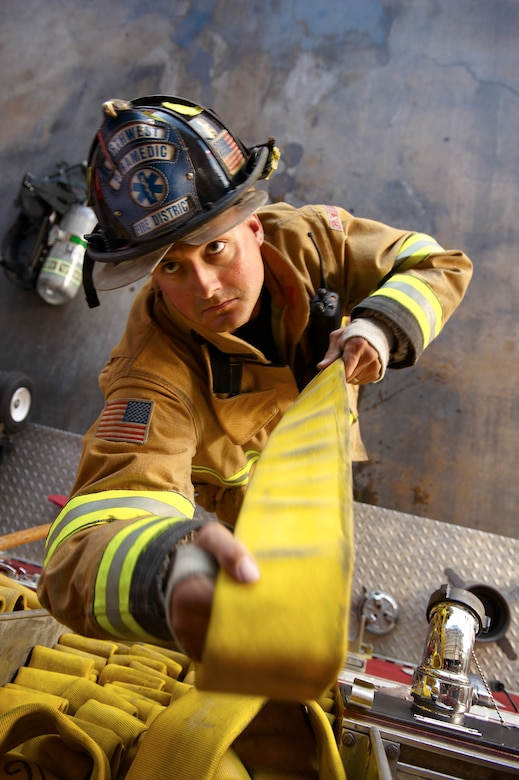 """Tech. Sgt. Dave Arneson is photographed by an Air National Guard Creative Team photographer for a """"Go ANG"""" recruiting campaign. This month the Arizona Guardsman will receive """"Firefighter of the Year"""" honors at the annual Air National Guard Fire Chief Association conference in Atlanta. (U.S. Air Force photo/Senior Master Sgt. Rob Trubia)"""