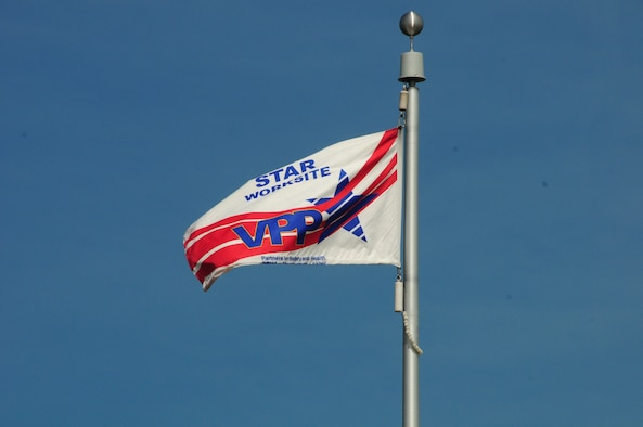 The Voluntary Protection Program flag flies proudly at the 148th Fighter Wing.  The 148th Fighter Wing has just been recertified as part of the VPP as a Star worksite—the Star status is OSHA's highest rating. (U.S. Air Force photo by Master Sgt. Ralph Kapustka/released)