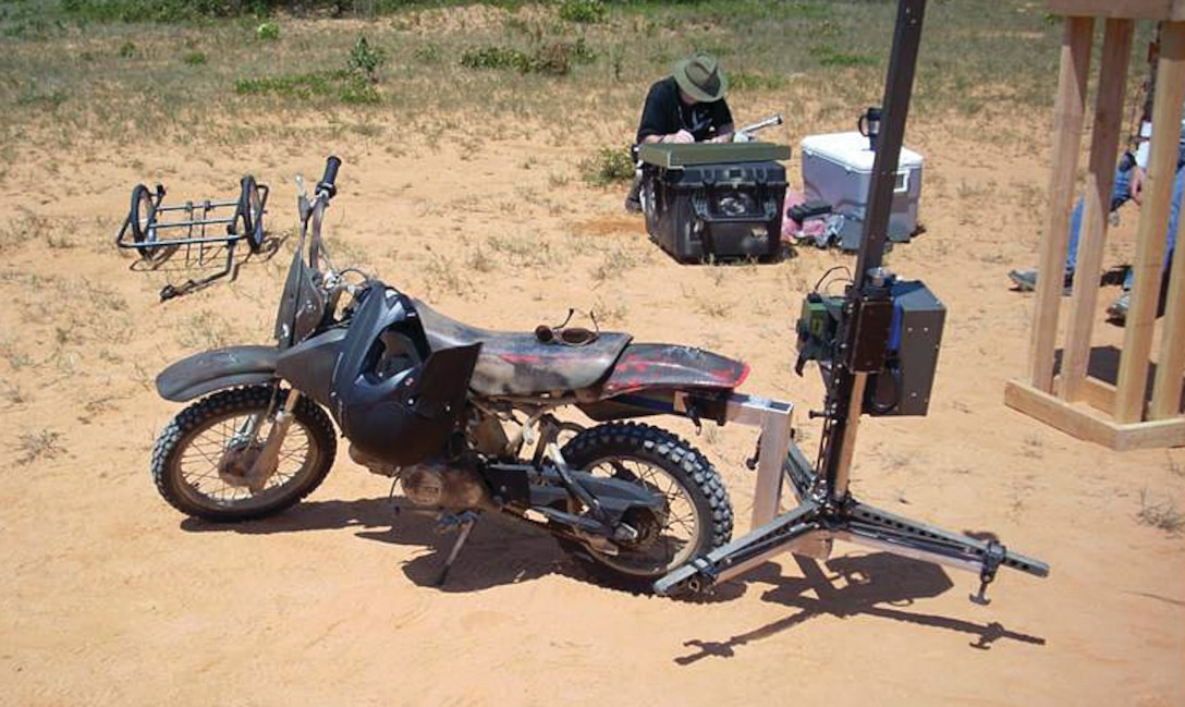 A small bike equipped with a removable hitch for a Mosquito, which provides the capability to measure ground hardness, a crucial element to landing zone preparation. The Air Force Research Laboratory responded to an urgent warfighter request, delivering the prototype for the mounting and towing mechanism in just two weeks.