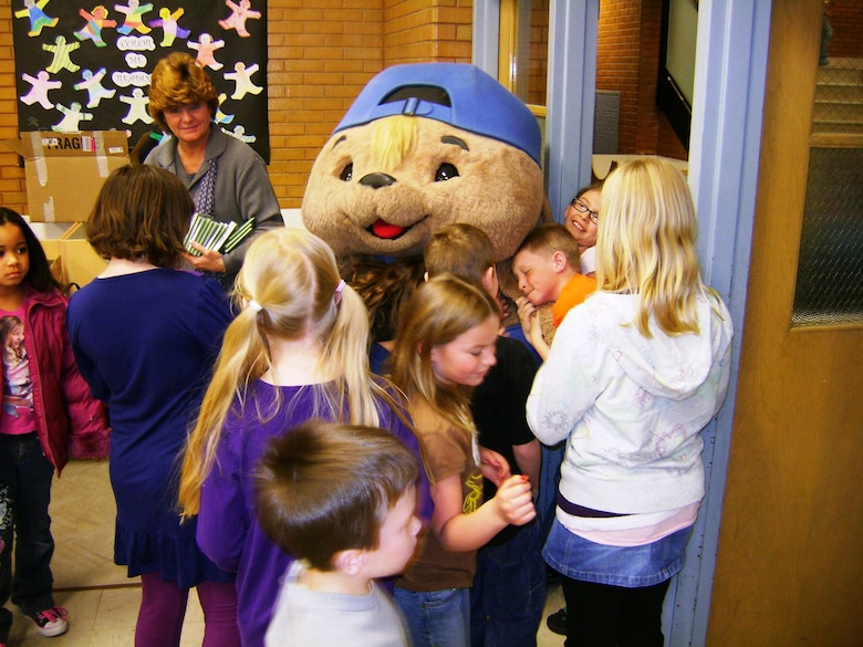 "Sammy Rabbit greets kids after a recent show. Author Sam Renick and his ""Sammy Rabbit"" children's book character will be coming to Hanscom Aug. 19 to teach children tips about finances. (Courtesy photo)"