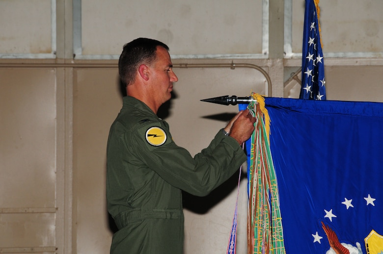Col. Frank Detorie, 103rd Airlift Wing commander, pins the unit flag with the Air Force Outstanding Unit of the Year Award streamer during the annual awards ceremony at Bradley Air National Guard Base, East Granby, Conn. June 4, 2011. (U.S. Air Force photo by Airman 1st Class Emmanuel Santiago)
