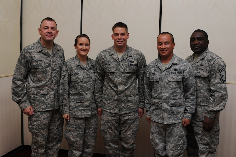 Col. Richard McComb (left) and Chief Master Sgt. Thomas Jackson recognize  Airmen 1st Class Krista Kerry, A1C Gabriel Lazurka and A1C Michael Ang as Diamond Sharp award winners during a ceremony at the Charleston Club Aug. 9. Diamond Sharp awardees are Airmen chosen by their first sergeants for their excellent performance. McComb is the Joint Base Charleston commander, Jackson is the 628th Communications Squadron superintendent, Kerry is from the 628th Logistics Readiness Squadron, Lazurka is from the 628th Comptroller Squadron and Ang is from the 628th Civil Engineer Squadron. Also receiving the Diamond Sharp award but not pictured was Senior Airman Johnny Scott from the 628th Contracting Squadron. (U.S. Air Force photo/Staff Sgt. Nicole Mickle)
