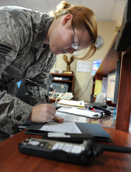 Senior Airman Maria McKee, 39th Operations Squadron airfield management shift lead, fills out a hand receipt for a land mobile radio Aug. 10, 2011, at Incirlik Air Base, Turkey. Airfield management use LMRs to communicate with the air traffic control tower to ensure they do not cross a runway with an aircraft taking off or landing. (U.S. Air Force photo/Senior Airman Anthony Sanchelli)(Released)