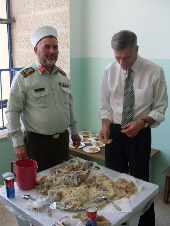 On the last day of the visit, the group enjoyed a traditional meal composed of four huge round trays covered with rice and slivered almonds; each tray was a sizeable cooked goat. Mufti (their senior chaplain) and Chaplain Prosise enjoyed the Mansef together. (Photo courtesy of Army Col. Andy Meverden, Colorado National Guard Chaplain)