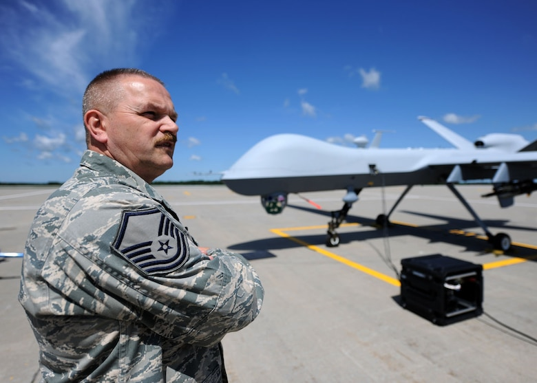 U.S. Air Force Master Sgt. Steven Burbidge, a  MQ-9 Reaper crew chief with the 174th Fighter Wing, stands ready to launch the first MQ-9 at Wheeler-Sack Army Air Field at Ft. Drum, NY on 30 June 2011. This initial ground operation is the precurser to the 174th FW flying off of Wheeler-Sack AAF upon final approval by the FAA.  The 174 FW eventually intends to fly the MQ-9 from its main base at Hancock Field, Syracuse, NY.  (US Air Force photo by Tech. Sgt. Jeremy Call)